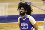 Washington's Marcus Tsohonis smiles during an NCAA college basketball practice Tuesday, Oct. 27, 2020, in Seattle. The Huskies are coming off a disappointing season during which they crumbled in conference play, finishing last in the Pac-12.  (AP Photo/Elaine Thompson)