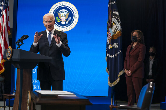 Vice President Kamala Harris listens as President Joe Biden answers questions from reporters in the South Court Auditorium on the White House complex, Monday, Jan. 25, 2021, in Washington, as Vice President Kamala Harris listens. (AP Photo/Evan Vucci)