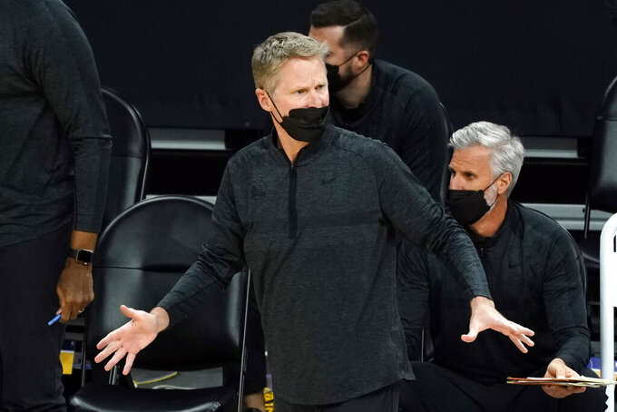 Golden State Warriors head coach Steve Kerr reacts to a call during the first half of an NBA basketball game against the Phoenix Suns, Thursday, March 4, 2021, in Phoenix. (AP Photo/Rick Scuteri)