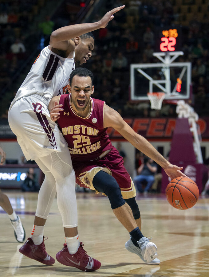 Boston College center Will Jackowitz (24) drives past Virginia Tech forward Kerry Blackshear Jr. (24) during the first half of an NCAA college basketball game Saturday, Jan. 5, 2019, in Blacksburg, Va. Tech won 77-66. (AP Photo/Don Petersen)