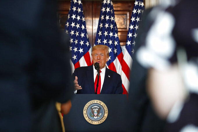 President Donald Trump speaks during an event to present the Presidential Medal of Freedom to Jim Ryun, in the Blue Room of the White House, Friday, July 24, 2020, in Washington. (AP Photo/Alex Brandon)