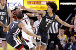 Arizona State guard Remy Martin (1) loses the ball under pressure from Washington State forward CJ Elleby (2) and guard Jervae Robinson (1) during the first half of an NCAA college basketball game Saturday, March 7, 2020, in Tempe, Ariz. (AP Photo/Matt York)