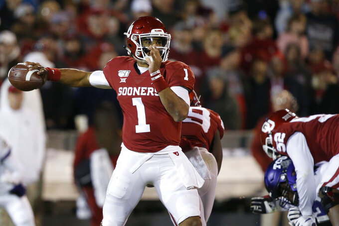Oklahoma quarterback Jalen Hurts (1) passes in the first half of an NCAA college football game against TCU in Norman, Okla., Saturday, Nov. 23, 2019. (AP Photo/Sue Ogrocki)