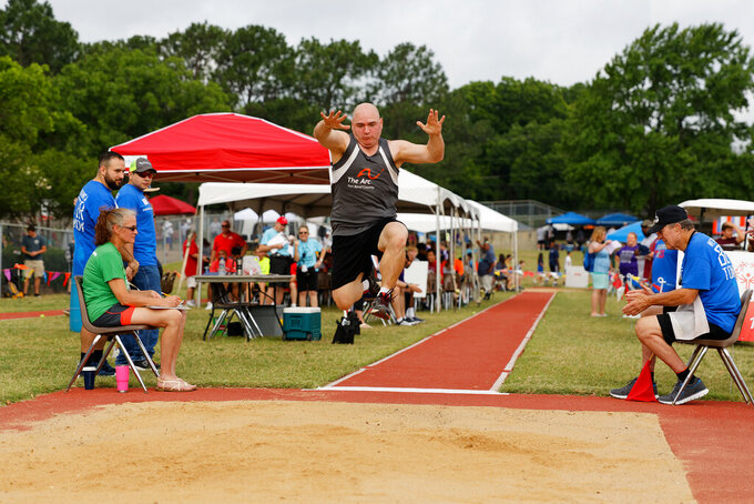 """In this photo provided by Gary Schottle, Derek """"Tank"""" Schottle competes in the long jump as part of the Pentathlon competition at the Texas Special Olympics track meet in Arlington, Texas, on May 27, 2017. The Special Olympics, founded by Eunice Kennedy Shriver, have melded competition and inclusion for people with intellectual disabilities since the first games were held in 1968. Special Olympics has since branched out to 174 countries, empowering more than five million athletes who had often been cast aside.(Gary Schottle via AP)"""