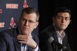 FILE - In this Jan. 15, 2020, file photo, Boston Red Sox team CEO Sam Kennedy, left, and Chief Baseball Officer Chaim Bloom participate during a news conference at Fenway Park in Boston. The Boston Red Sox were stripped of their second-round pick in this year's amateur draft by Major League Baseball for breaking video rules in 2018 and former manager Alex Cora was suspended through the 2020 postseason for his conduct as bench coach with the Houston Astros the previous year. Baseball Commissioner Rob Manfred announced his decision Wednesday, April 22, 2020, concluding Red Sox replay system operator J.T. Watkins used in-game video to revise sign sequences provided to players. (AP Photo/Elise Amendola, File)