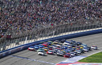 NASCAR Cup Series cars line up five wide in a salute to fans during pace laps for the NASCAR Cup Series auto race at Auto Club Speedway, in Fontana, Calif., Sunday, March 17, 2019. (AP Photo/Rachel Luna)