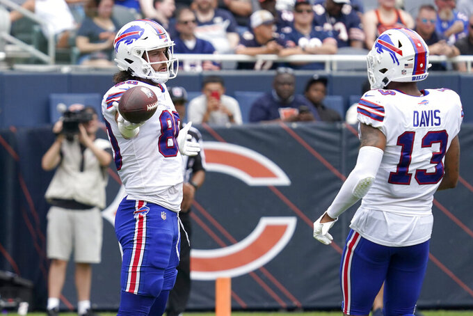 Buffalo Bills' Jacob Hollister celebrates his touchdown pass from quarterback Mitchell Trubisky with Gabriel Davis during the first half of an NFL preseason football game Chicago Bears Saturday, Aug. 21, 2021, in Chicago. (AP Photo/Nam Y. Huh)