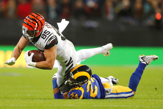 Cincinnati Bengals tight end Tyler Eifert, left, is tackled by Los Angeles Rams safety Taylor Rapp during the first half of an NFL football game, Sunday, Oct. 27, 2019, at Wembley Stadium in London. (AP Photo/Frank Augstein)