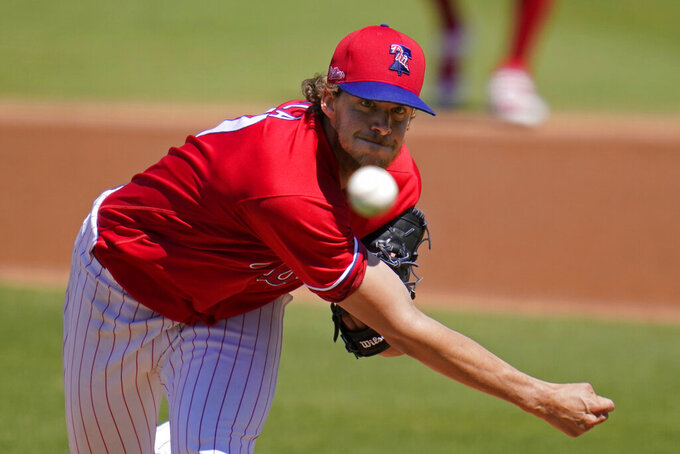 Philadelphia Phillies starting pitcher Aaron Nola delivers during the first inning of a spring training baseball game against the New York Yankees in Clearwater, Fla., Thursday, March 11, 2021. (AP Photo/Gene J. Puskar)