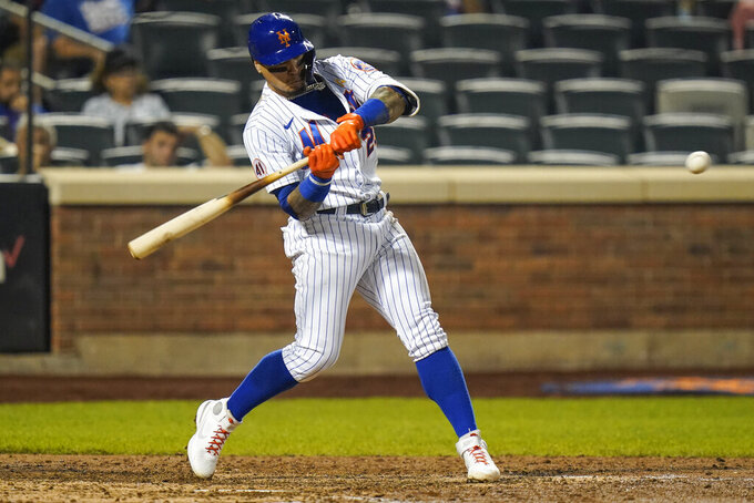New York Mets' Javier Baez (23) hits a home run during the ninth inning of a baseball game against the St. Louis Cardinals Tuesday, Sept. 14, 2021, in New York. (AP Photo/Frank Franklin II)