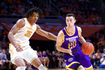 Tennessee Tech guard Hunter Vick (20) brings the ball down court against Tennessee forward Yves Pons (35) in the first half of an NCAA college basketball game Saturday, Dec. 29, 2018, in Knoxville, Tenn. (AP Photo/Shawn Millsaps)