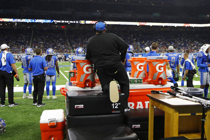 Detroit Lions coach Matt Patricia watches from behind the team during the second half of a preseason NFL football game against the New England Patriots on Thursday, Aug. 8, 2019, in Detroit. Patricia is recovering from leg surgery and had been using an ATV to get around during training, but the NFL rules forbid such equipment on the sideline. (AP Photo/Carlos Osorio)