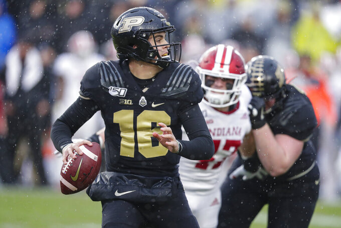 In this photo taken on Saturday, Nov. 30, 2019, Purdue quarterback Aidan O'Connell (16) throws against Indiana during the first half of an NCAA college football game in West Lafayette, Ind. (AP Photo/Michael Conroy)
