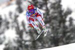 Switzerland's Beat Feuz speeds down the course during an alpine ski, men's World Cup downhill, in Kitzbuehel, Austria, Sunday, Jan. 24, 2021. (AP Photo/Marco Trovati)