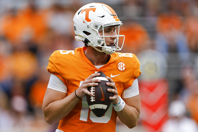 Tennessee quarterback Harrison Bailey (15) looks for a receiver during the second half of an NCAA college football game against Tennessee Tech, Saturday, Sept. 18, 2021, in Knoxville, Tenn. Tennessee won 56-0. (AP Photo/Wade Payne)