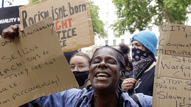 Demonstrators chant slogans during a rally at Downing Street in London, Tuesday, June 9, 2020. The rally is to commemorate George Floyd whose private funeral takes place in the US on Tuesday. (AP Photo/Kirsty Wigglesworth)