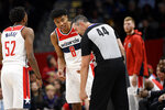 Washington Wizards forward Rui Hachimura (8), of Japan, reacts next to referee Brett Nansel (44) after he was called for a foul during the second half of an NBA basketball game against the Orlando Magic, Tuesday, Dec. 3, 2019, in Washington. The Magic won 127-120. (AP Photo/Nick Wass)