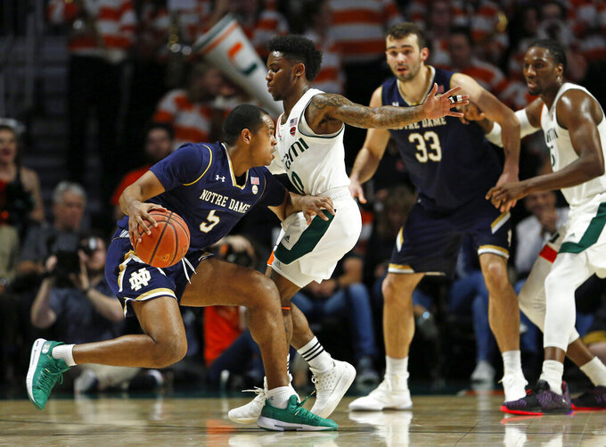 Notre Dame guard D.J. Harvey (5) drives against Miami guard Chris Lykes (0) during the first half of an NCAA college basketball game, Wednesday, Feb. 6, 2019 in Coral Gables, Fla. (David Santiago/Miami Herald via AP)