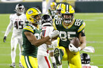 Green Bay Packers' Robert Tonyan (85) celebrates a touchdown reception with Malik Taylor (86) during the first half of an NFL football game against the Atlanta Falcons, Monday, Oct. 5, 2020, in Green Bay, Wis. (AP Photo/Mike Roemer)