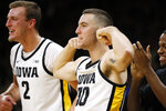 Iowa' Connor McCaffery, second from left, and Jack Nunge, left, celebrate on the bench during the second half of an NCAA college basketball game against Oral Roberts, Friday, Nov. 15, 2019, in Iowa City, Iowa. (AP Photo/Charlie Neibergall)