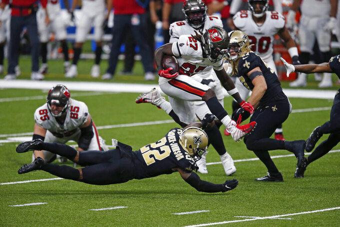 Tampa Bay Buccaneers running back Ronald Jones (27) carries against New Orleans Saints safety Chauncey Gardner-Johnson (22) in the second half of an NFL football game in New Orleans, Sunday, Sept. 13, 2020. (AP Photo/Butch Dill)