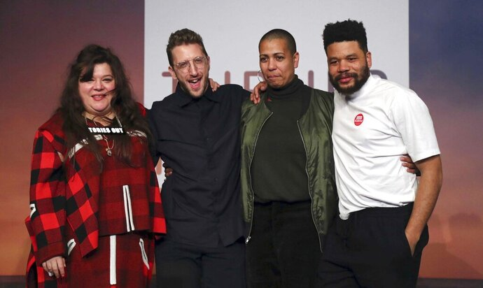 Tai Shani, Lawrence Abu Hamdan, Helen Cammock and Oscar Murillo, after being announced as the winners for the 2019 Turner Prize at Dreamland Margate Tuesday December 3, 2019. All four of the artists chosen as finalists won this year's award after they wrote to the jury and asked to be treated as a collective, prize organizers said Tuesday. (Gareth Fuller/PA via AP)