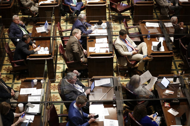 House members are separated by glass partitions due to the coronavirus pandemic during a House session Tuesday, June 9, 2020, in Nashville, Tenn. (AP Photo/Mark Humphrey)