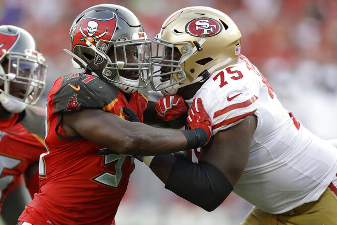 Tampa Bay Buccaneers linebacker Shaquil Barrett (58) drives against San Francisco 49ers offensive guard Laken Tomlinson (75) during the second half an NFL football game, Sunday, Sept. 8, 2019, in Tampa, Fla. (AP Photo/Chris O'Meara)