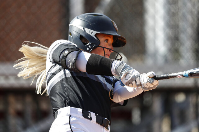 FILE - In this March 6, 2020, file photo, Purdue Fort Wayne's Rachel Everson connects for a hit during an NCAA softball game against UMass Lowell in Clarksville, Tenn. The NCAA Division I Council is scheduled Monday, March 30, 2020, to vote on providing another year of eligibility to spring sport athletes, such as baseball, softball and lacrosse players, who had their seasons wiped out by the coronavirus pandemic. (AP Photo/Wade Payne, File)