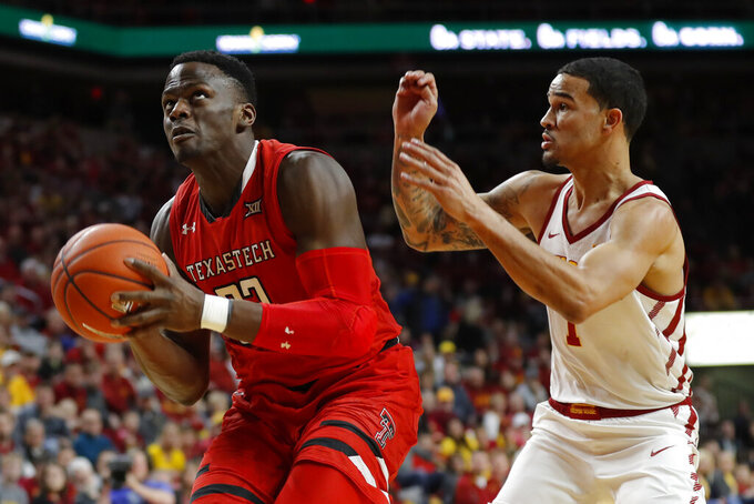 Texas Tech center Norense Odiase drives to the basket past Iowa State guard Nick Weiler-Babb, right, during the first half of an NCAA college basketball game, Saturday, March 9, 2019, in Ames, Iowa. (AP Photo/Charlie Neibergall)