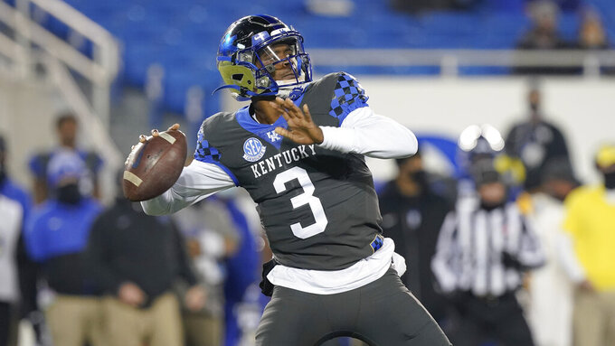 Kentucky quarterback Terry Wilson (3) throws the ball during an NCAA college football game against South Carolina, Saturday, Dec. 5, 2020, in Lexington, Ky.  North Carolina State (8-3) is a 2 ½-point underdog against Kentucky (4-6) in the TaxSlayer Gator Bowl, a number the Wolfpack consider a slight heading into Saturday, Jan. 2, 2021 game in Jacksonville.  (AP Photo/Bryan Woolston)