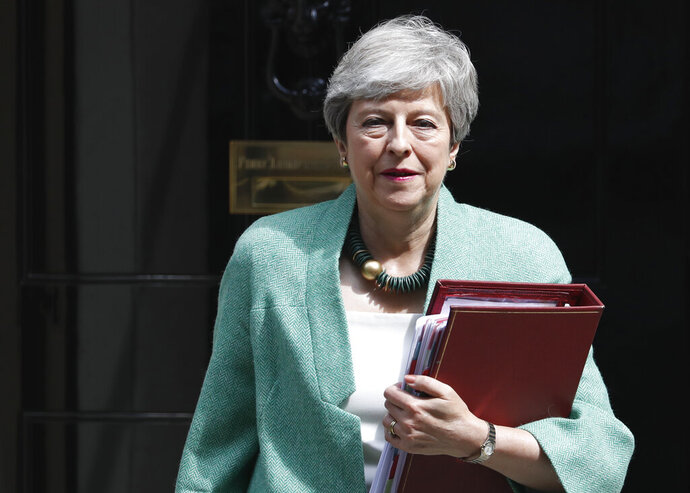 Britain's Prime Minister Theresa May leaves 10 Downing Street for her weekly Prime Minister's Questions at the House of Commons in London, Wednesday, July 10, 2019. (AP Photo/Alastair Grant)