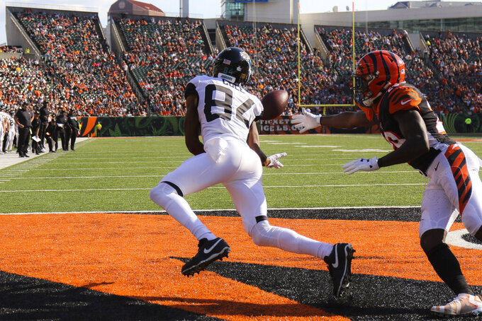 Jacksonville Jaguars wide receiver Keelan Cole (84) catches a touchdown pass against Cincinnati Bengals cornerback Tony McRae, right, in the second half of an NFL football game, Sunday, Oct. 20, 2019, in Cincinnati. (AP Photo/Gary Landers)
