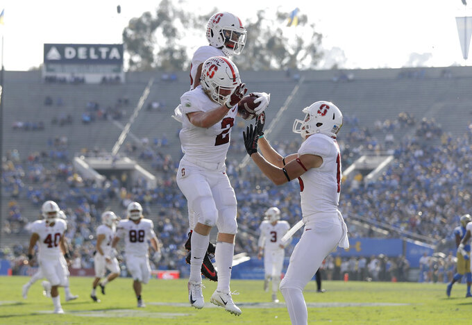 Stanford wide receiver Trenton Irwin (2) celebrates his touchdown catch with teammates during the first half of an NCAA college football game against UCLA Saturday, Nov. 24, 2018, in Pasadena, Calif. (AP Photo/Marcio Jose Sanchez)