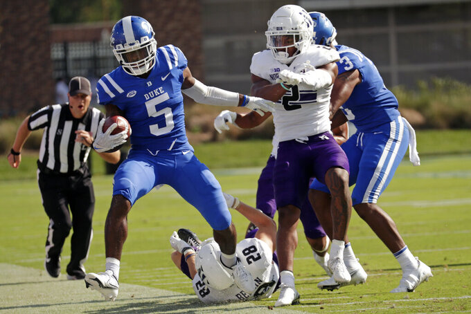Duke wide receiver Jalon Calhoun (5) is run out of bounds by Northwestern defensive back Cameron Mitchell (2) and linebacker Chris Bergin (28) during the first half of an NCAA college football game in Durham, N.C., Saturday, Sept. 18, 2021. (AP Photo/Chris Seward)
