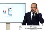 French Prime Minister Edouard Philippe speaks during a televised address next to a screen showing the future in Paris Thursday, May 28, 2020. France is reopening its restaurants, bars and cafes starting next week as the country eases most restrictions amid the coronavirus crisis. Edouard Philippe defended the gradual lifting of lockdown up to now, saying the strategy was meant to avoid provoking a second wave. French lawmakers approved France's contact-tracing app designed to contain the spread of the coronavirus. (Philippe Lopez, Pool via AP)