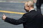 FILE - In this June 24, 2020, file photo, Russian President Vladimir Putin gestures as he leaves Red Square after the Victory Day military parade marking the 75th anniversary of the Nazi defeat in Moscow, Russia. Putin is just a step away from bringing about the constitutional changes that would allow him to extend his rule until 2036. The vote that would reset the clock on Putin's tenure in office and allow him to serve two more six-year terms is set to wrap up Wednesday, July 1, 2020. (AP Photo/Pavel Golovkin, Pool, File)