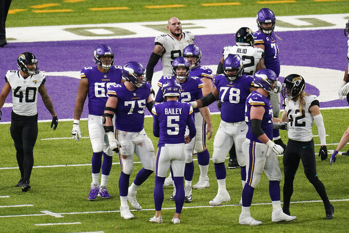 Minnesota Vikings place kicker Dan Bailey (5) celebrates with teammates after kicking a 23-yard field goal during overtime in an NFL football game against the Jacksonville Jaguars, Sunday, Dec. 6, 2020, in Minneapolis. The Vikings won 27-24. (AP Photo/Charlie Neibergall)