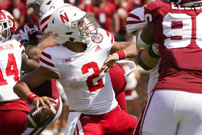 Nebraska quarterback Adrian Martinez (2) throws in the second half of an NCAA college football game against Oklahoma, Saturday, Sept. 18, 2021, in Norman, Okla. (AP Photo/Sue Ogrocki)