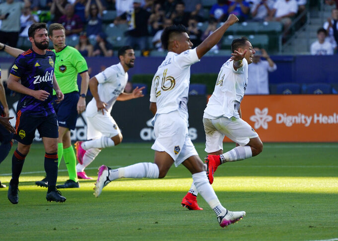 LA Galaxy forward Javier Hernandez, right, and midfielder Efrain Alvarez, second from right, celebrate a goal by midfielder Sacha Kljestan during the first half of a Major League Soccer match against the Seattle Sounders Saturday, June 19, 2021, in Carson, Calif. (AP Photo/Mark J. Terrill)