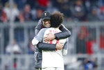 Liverpool coach Juergen Klopp hugs Liverpool forward Mohamed Salah after the Champions League round of 16 second leg soccer match between Bayern Munich and Liverpool in Munich, Germany, Wednesday, March 13, 2019. (AP Photo/Matthias Schrader)