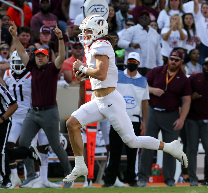 Virginia Tech quarterback Connor Blumrick (4) runs for a first down in the second half of an NCAA college football game against Middle Tennessee, Saturday, Sept. 11, 2021, in Blacksburg Va. (AP Photo/Matt Gentry)