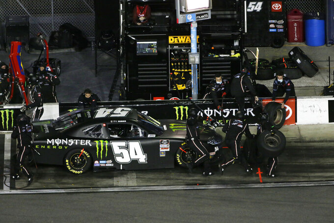 Ty Gibbs makes a pit stop during during the NASCAR Xfinity Series road course auto race at Daytona International Speedway, Saturday, Feb. 20, 2021, in Daytona Beach, Fla. Gibbs went on to win the race. (AP Photo/Terry Renna)