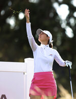 Cheyenne Knight checks the wind on the second tee during the first round of the LPGA Cambia Portland Classic golf tournament in West Linn, Ore., Thursday, Sept. 16, 2021. (AP Photo/Steve Dipaola)