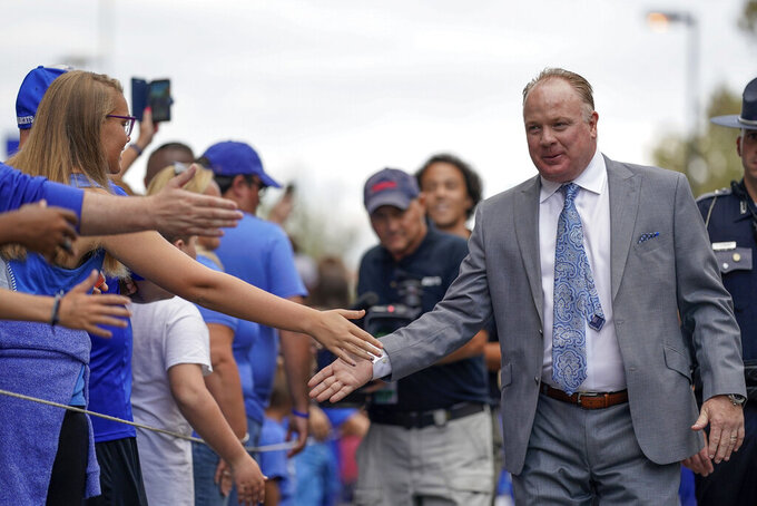 Kentucky head coach Mark Stoops greets fans prior to an NCAA college football game between Kentucky and Eastern Michigan, Saturday, Sept 7, 2019, in Lexington, Ky. (AP Photo/Bryan Woolston)