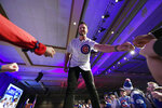 Chicago Cubs' Kris Bryant fist-bumps fans after being announced during the baseball team's convention Friday, Jan. 17, 2020, in Chicago. (AP Photo/Paul Beaty)