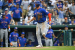 New York Mets' Pete Alonso runs home to score on a single by Michael Conforto during the ninth inning of a baseball game against the Washington Nationals, Sunday, Sept. 5, 2021, in Washington. (AP Photo/Nick Wass)