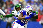 Buffalo Bills running back Frank Gore (20) runs past New York Jets outside linebacker James Burgess (58) during the first half of an NFL football game Sunday, Dec. 29, 2019, in Orchard Park, N.Y. (AP Photo/David Dermer)