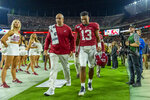 Alabama quarterback Tua Tagovailoa (13) walks off the field hurt against Tennessee during the first half of an NCAA college football game, Saturday, Oct. 19, 2019, in Tuscaloosa, Ala. (AP Photo/Vasha Hunt)