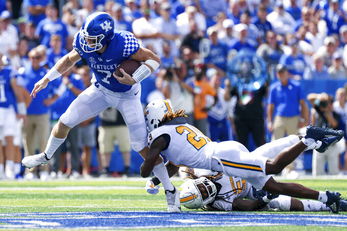 Kentucky quarterback Will Levis (7) gets tackled by Chattanooga defensive back Telly Plummer (29) during the second half of their NCAA college football game in Lexington, Ky., Saturday, Sept. 18, 2021. (AP Photo/Michael Clubb)
